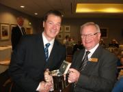 Paul Bennett collects the Old Xavs Reserves Sportsmanship Trophy from LCPL Chairman Pat Farrell